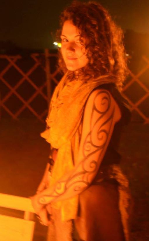 Michelle Beck, with woad, in firelight at the Aerie of Tir Thalor, Pennsic XLIII (used with permission)
